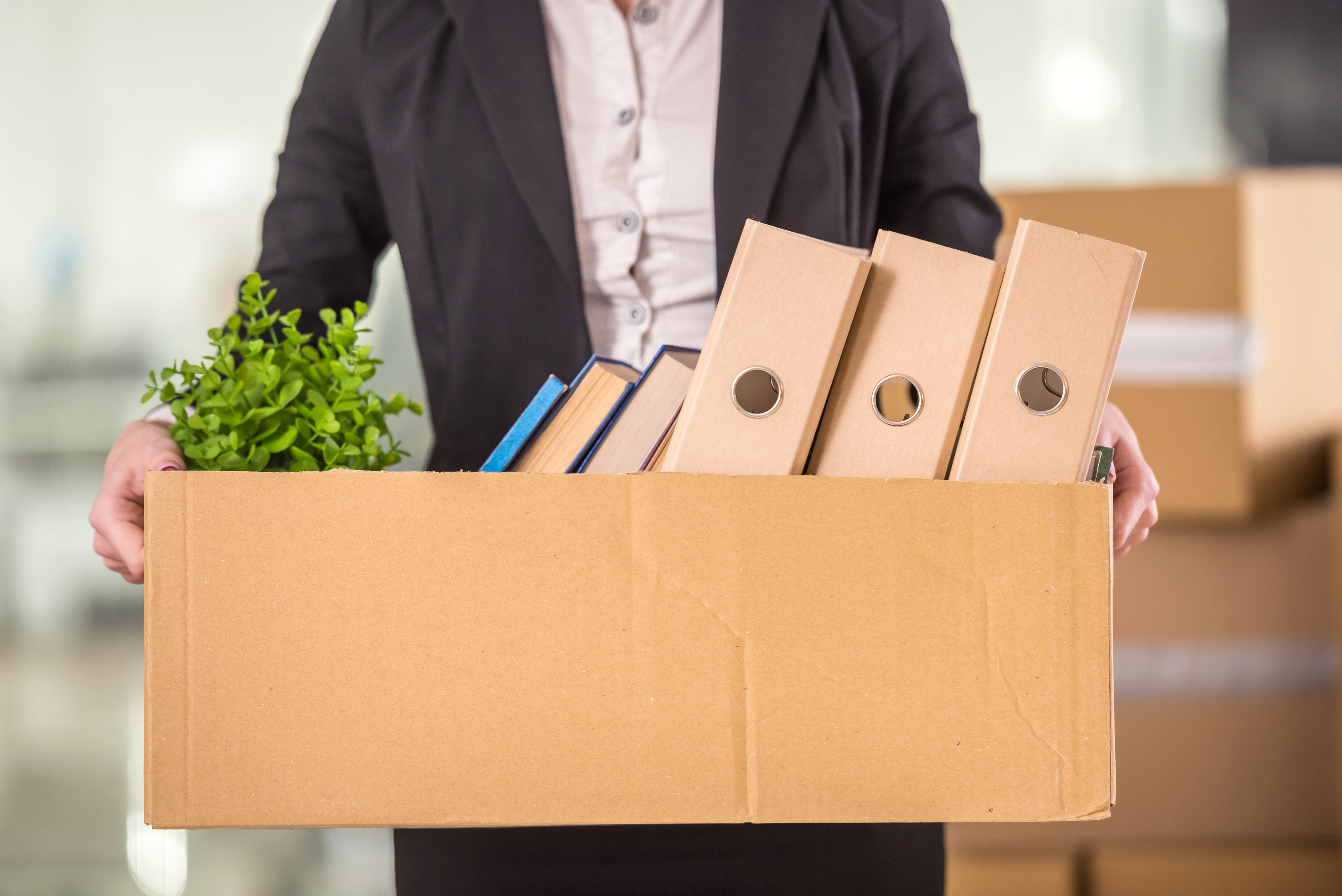100115-corporate-relocation-box-full-of-business-files-shutterstock_2707557831